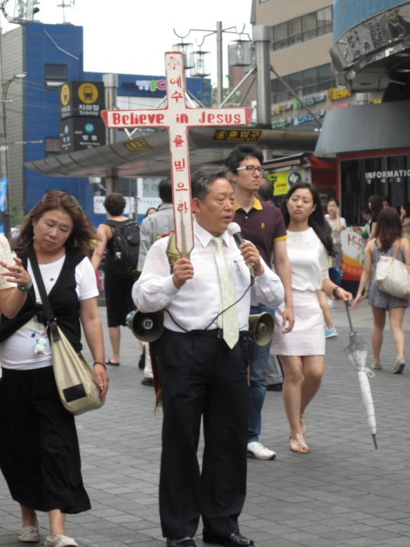 "I guess shopping attracts sinners, because these firebrand Korean missionaries creep around yelling things like ""devildevildeviljejussuhhell!"" into their microphones for hours on end."
