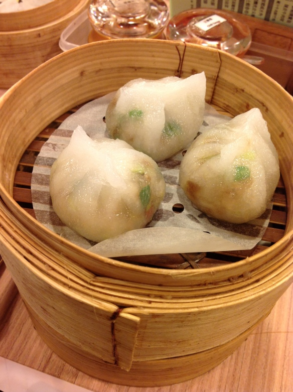 These dumplings were filled with green onion, water chestnut, and meat. Delicious.