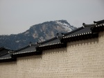 Gyeongbokgung palace walls with snowy mountains
