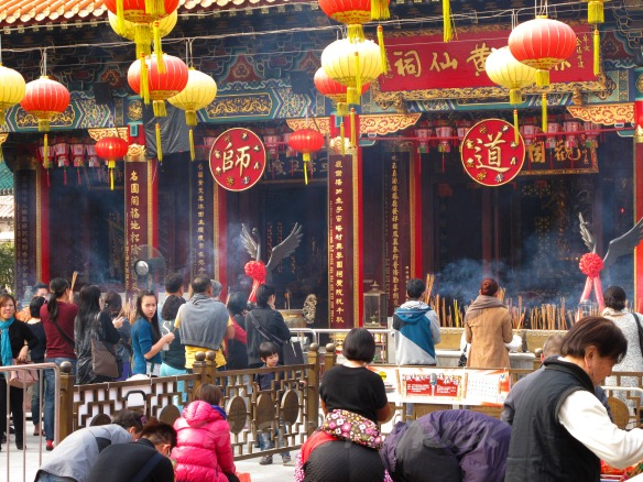 Incense smoke filling the air in Wong Tai Sin temple.